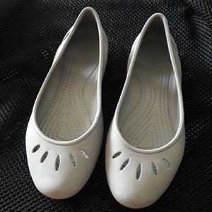 Crocs gray flats